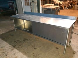 Stainless steel 8' table with cabinet