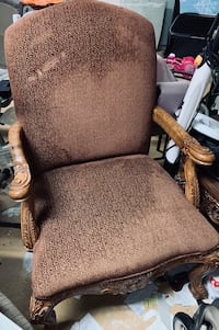 brown wooden frame black padded armchair