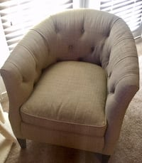 brown and beige fabric sofa chair