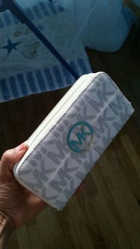 monogrammed white Michael Kors leather zip pouch