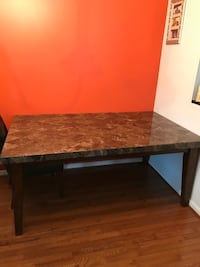 Solid Marble Table with 4 brown leather chairs. Seats up to 6.  Table is a steal, it is well made and can add elegance to any new home. $700 obo Temple Hills, 20748