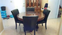 oval brown wooden dining table with chairs set Seminole, 33772