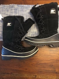 pair of black-and-white Sorel duck boots Halifax, B3K 4A3