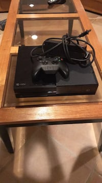 black Xbox One console with controller 29 km