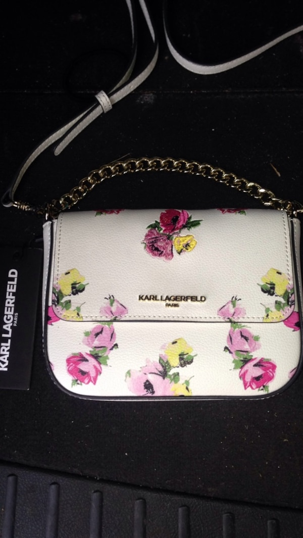 **BRAND NEW** Karl Lagerfeld purse. Beautiful inside and out with slight floral