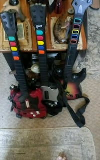 3 guitar heros one is a gibson with straps for ps2 Glenville, 17329