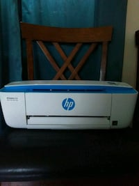 white and blue HP printer Savannah