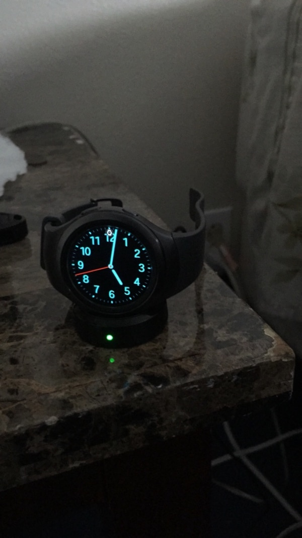 Round black digital samsung gear 2 watch with black strap