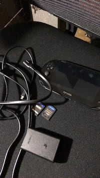 Barely Used PS Vita + 2 games and charging cables.