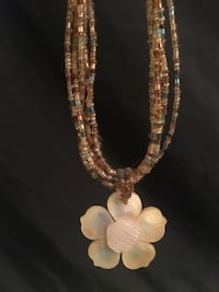 Beaded necklace with seashell flower pendant