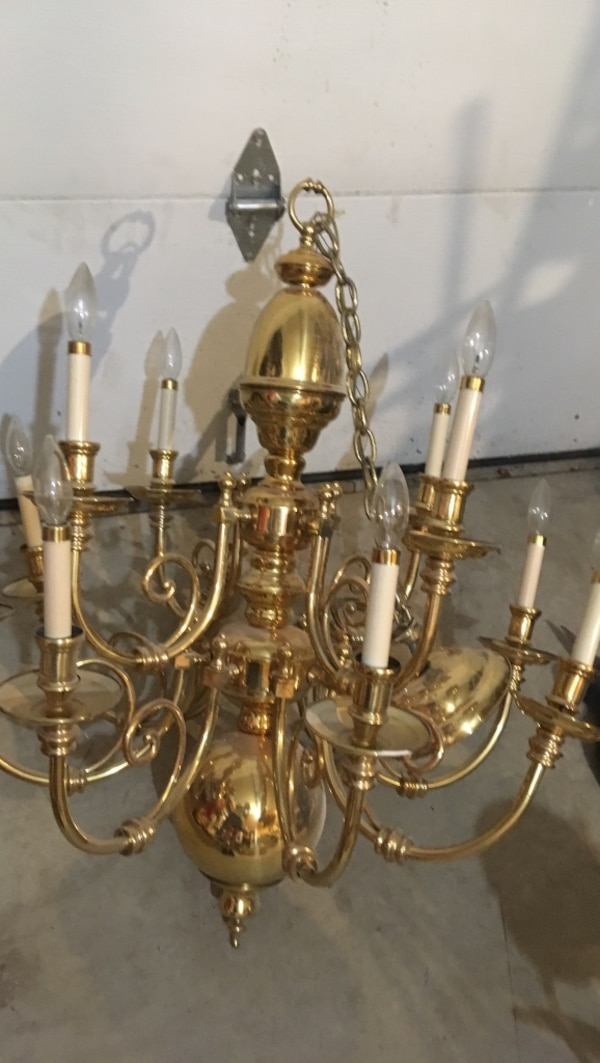 Brass-colored uplight chandelier