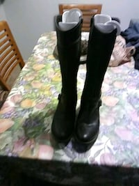 pair of black leather buckled riding boots