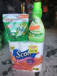 two Gain and Tide detergent bottles 2251 mi