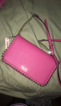 pink leather crossbody bag with silver link bracelet St. Louis, 63106