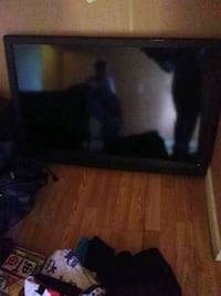black flat screen TV with remote Commerce City
