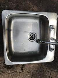 Silver steel sink with silver faucet Dollard-des-Ormeaux, H9A 2H1