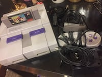 white Nintendo Wii console with controller and game cases