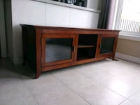 "Solid wood tv stand. Measure 62""x20""x22"" Newmarket, L3X 2X4"