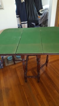 "Folding table and 2 chairs with custom size table mat. Opens to 44'' x 36"". If ad is up item is available."
