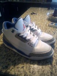 pair of white Air Jordan 3's 1357 mi