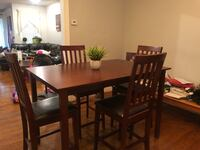 Rectangular brown wooden table with four chairs dining set Philadelphia, 19149