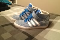 White-gray-and-blue adidas high-top sneakers