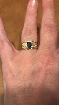 gold-colored diamond encrusted ring