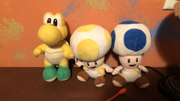 Three super mario character plush toys