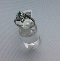 14kt white gold fashion ring swirl design w 10 round diamonds and centered marquise emerald .size 7.75