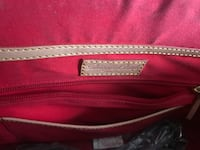 Authentic Dooney and Bourke like new. Strap still in plastic Lynchburg, 24504