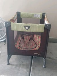 baby's green and brown Cosco travel cot Indio, 92201