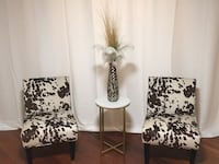 Two cowhide padded chairs 1 end table & vase more if needed Harrison, 10528
