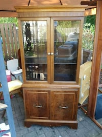 brown wooden framed glass display cabinet Ottawa, K2G 0A5