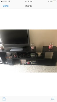 black flat screen TV with black wooden TV stand Port Jefferson Station, 11776