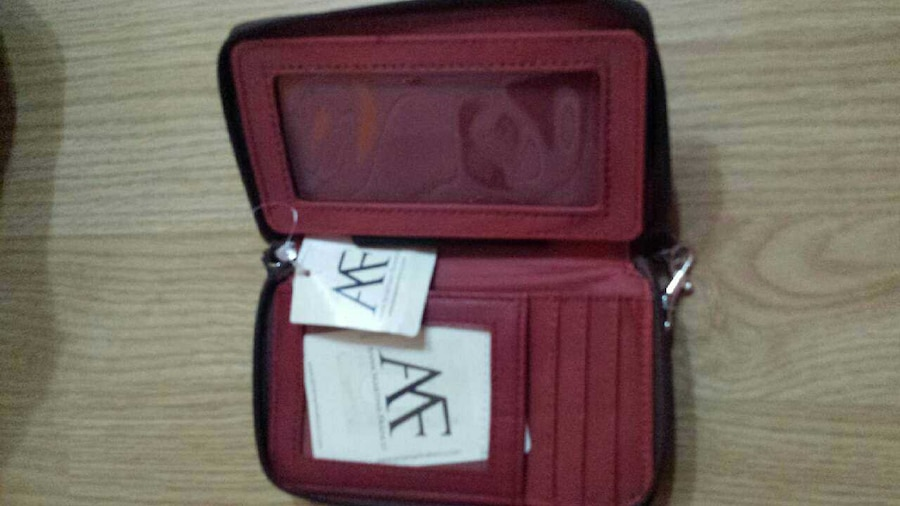 red leather trifold wallet - Negotiable