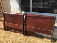 two brown wooden headboards