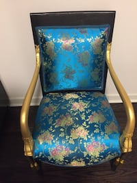 blue and brown floral padded armchair