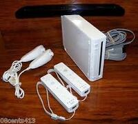 Nintendo Wii 4 remotes 5 games  Kitchener