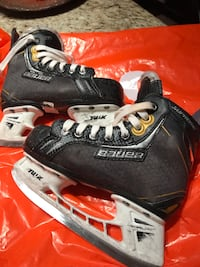 pair of black Bauer ice hockey skates Toronto, M6N 0A6