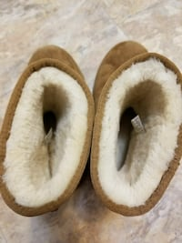 pair of brown-and-white fur slippers