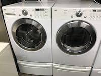 white front load washing machine and dryer