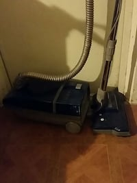 blue and gray canister vacuum cleaner