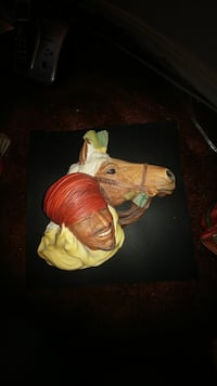 man and horse bust