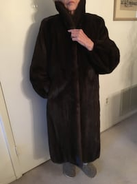long mink coat. Fits sizes 10 to 16. No holes.  Lining is intact. Lutherville Timonium, 21093