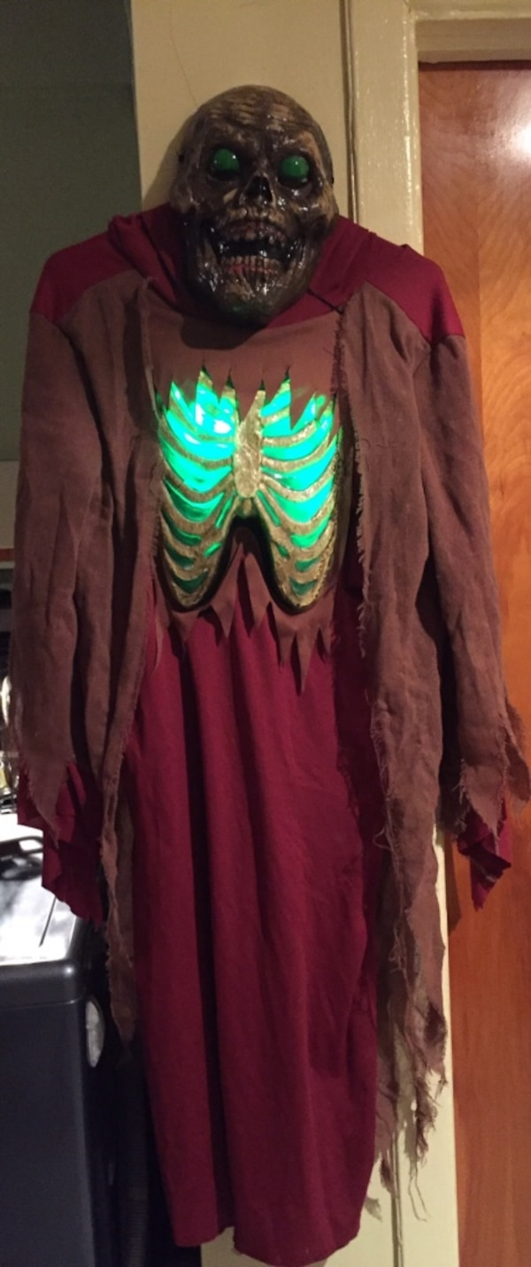 Kids Halloween costume.Battery operated and lights up green ribcage. 13f1fb21-8b2c-4390-a195-efbf492909da