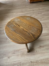"""Round brown wooden pedestal table 24 diameter and 19"""" floor to top   Temple Terrace, 33617"""