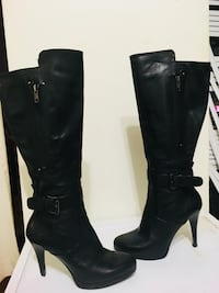 pair of black leather knee-high boots Toronto, M4Y