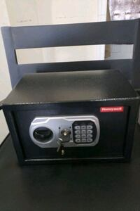 Safe with combinatio #,,key, manual and batteries.  Green Lane, 18054