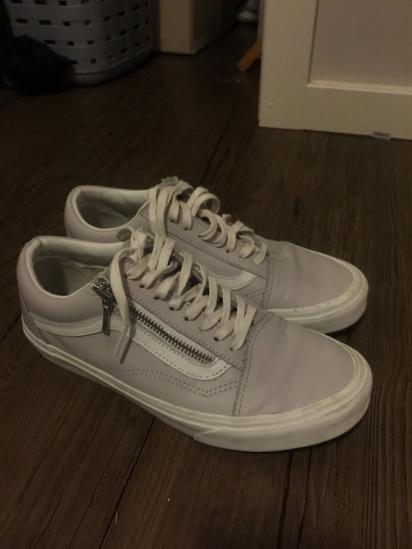 Pair of gray vans low-top sneakers leather