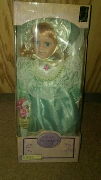 Collectible porcelain doll in package